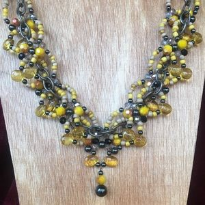 Yellow woven women's dangle necklace with chain.